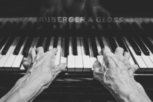 Older hands playing piano