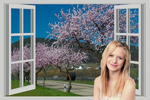 Girl With open windo showing spring flowering trees